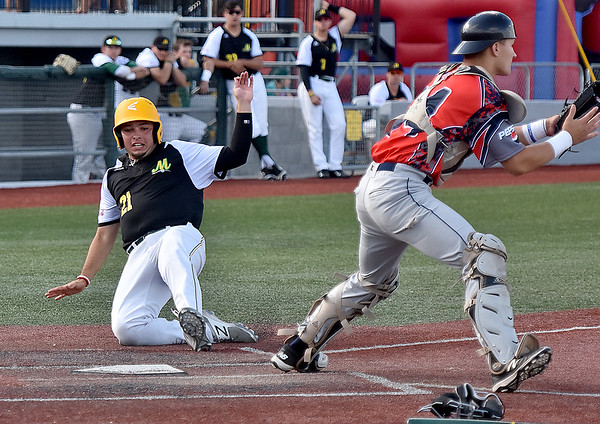 (Brad Davis/The Register-Herald) Miners baserunner Eddy Gonzalez comes in to score on a two-run hit by teammate Justin Mitchell that also scored Edwin Bonilla Sunday afternoon at Linda K. Epling Stadium.