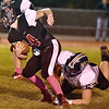 (Brad Davis/The Register-Herald) PikeView's Evan Rose is tripped up in the backfield by Nicholas County defender Colton Groves Friday night in Gardner.