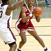 (Brad Davis/The Register-Herald) WVU recruit Derek Culver drives to the basket as Crossroads' (Class AAA) Iran Bennett defends during the Scott Brown memorial game Saturday evening at the Beckley-Raleigh County Convention Center.