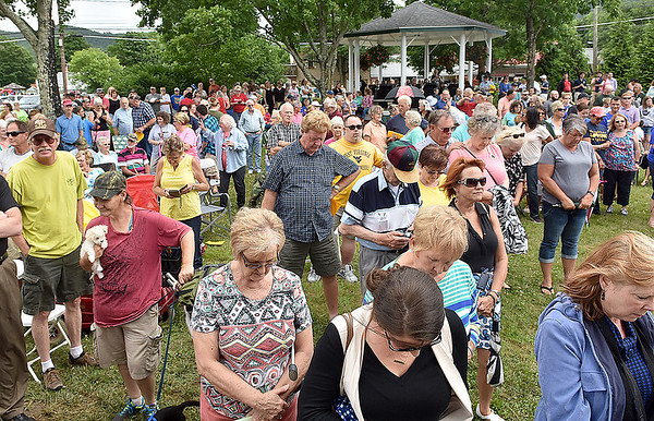 (Brad Davis/The Register-Herald) Residents pray together during a somber ceremony for the Old Mill Park Memorial dedication Friday afternoon in White Sulphur Springs