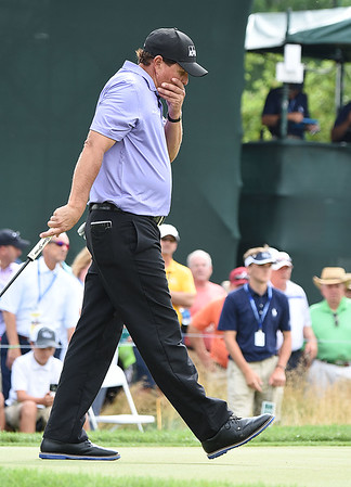 Phil Mickelson reacts after missing his birdie putt on the 18th hole during the second round of The Greenbrier Classic.<br /> (Rick Barbero/The Register-Herald)