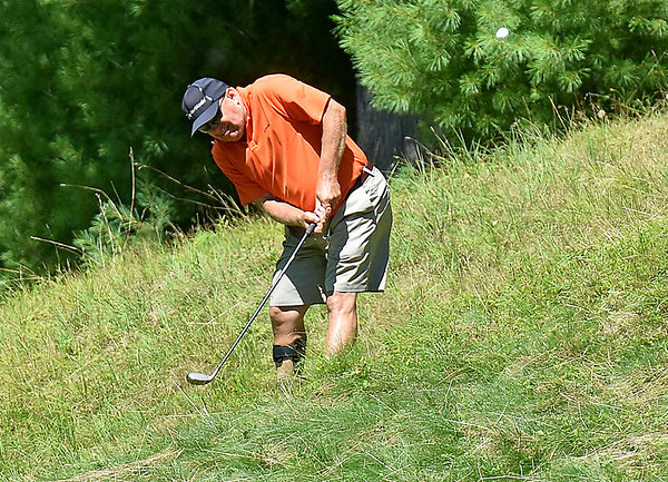 (Brad Davis/The Register-Herald) Rich Kissinger finds himself in a rough situation and up a hill during BNI action Sunday afternoon at Glade Springs' Stonehaven Golf Course.