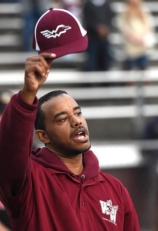 John Turner, assistant band director for Woodrow Wilson, raises his hat singing the schools song before the start of the game against Hurricane Friday night at Van Meter Stadium in Beckley.<br /> (Rick Barbero/The Register-Herald)