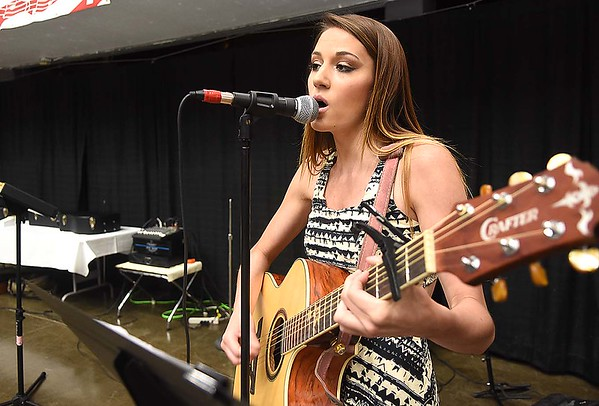 Jenna Lucas singing during the Senior Day Out at the Beckley Raleigh County Convetion Center.<br /> (Rick Barbero/The Register-Herald)