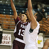 (Brad Davis/The Register-Herald) Virginia Episcopal's Jaelin Llewellyn drives and scores as First Love Christian's Mohamed Selmi defends during the opening night of the Battle for the Armory Basketball Tournament Thursday night at the Beckley-Raleigh County Convention Center.