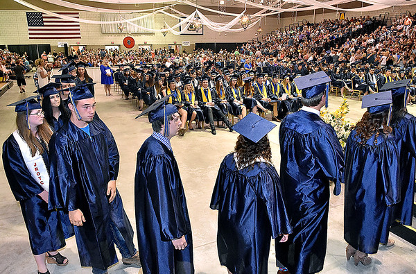 (Brad Davis/The Register-Herald) Graduating Nicholas County High School seniors line up to walk the stage and collect their diplomas during the school's 103rd Commencement Ceremony Sunday afternoon at the Summersville Arena