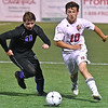 (Brad Davis/The Register-Herald) Woodrow Wilson's Austin Hatfield battles for possession with Riverside's Caleb Campbell Thursday night at the YMCA Paul Cline Memorial Sports Complex.