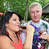 (Brad Davis/The Register-Herald) Beckley resident Karen Lilly and Hurricane resident Stu Frazier enjoy some wine and summer weather during Daniel Vineyards' Spring Wine Fest Saturday.