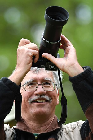 Bruce Moorman, of Ypsilanti Mich, takes pictures during a guided birding tour on the Burnwood Trail during the New River Birding and Nature Festival.<br /> (Rick Barbero/The Register-Herald)