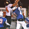 (Brad Davis/The Register-Herald) Summers County receiver Christian Pack and Midland Trail defender Thomas Ferris leap to snag a jump ball after quarterback Tucker Lilly's deep shot was underthrown Friday night at Nicholas County High School. Ferris would come away with an interception.