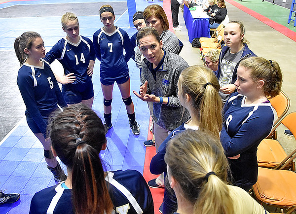 (Brad Davis/The Register-Herald) Shady Spring tries to regroup as head coach Kelly Williams talks to her players during a break in the Tigers match against Bridgeport at the State Volleyball Tournament Friday morning inside the Charleston Civic Center.