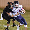 (Brad Davis/The Register-Herald) Independence's Hunter Mills is taken down by Summers County defender Tucker Lilly Friday night in Hinton.