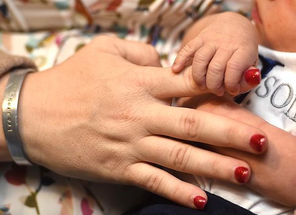 Erica Jones with her newly born son Greyson Xavier Jones.<br /> (Rick Barbero/The Register-Herald)