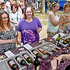 (Brad Davis/The Register-Herald) Beckley residents Lisa Hughes, far left, and Ashley Matics check out Lambert Vintage Wines' (Weston, WV) offerings during Daniel Vineyards' Spring Wine Festival Saturday afternoon in Crab Orchard.