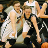 (Brad Davis/The Register-Herald) Westside's Riana Kenneda, right, and Wyoming East's Allie Lusk scramble for a loose ball during the Renegades' sectional championship win over county rival and defending state champion Wyoming East Wednesday night in Clear Fork.