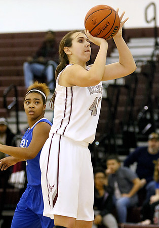 (Brad Davis/The Register-Herald) Woodrow Wilson's Madison Miller pulls up for a short-range jump shot against Capital Wednesday night in Beckley.