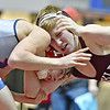 (Brad Davis/The Register-Herald) Woodrow Wilson's Caleb Click, right, takes on Independence's Ryan Dillon in a 132-pound weight class matchup during the West Virginia Army National Guard Duals Friday afternoon at the Beckley-Raleigh County Convention Center. Woodrow's Click would pin Dillon for the win.