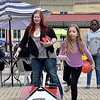 (Brad Davis/The Register-Herald) 10-year-old Beckley resident Genna Lewis tosses a beanbag at the target as her mom Elaine waits her turn during a game of cornhole at Sweet Treats Saturday afternoon.
