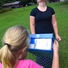 Kelly McGrady, of Beckley, right, uses solar glasses and her daughter Kayson McGrady views the solar eclispe with a pinhole camera made from shoe shoe box Monday afternoon at Grandview State Park. <br /> (Rick Barbero/The Register-Herald)