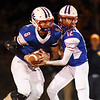 Midland Trail quarterback Austin Isaacs hands off to Thomas Ferris during their high school football game against Oak Hill Friday in Hico. (Chris Jackson/The Register-Herald)