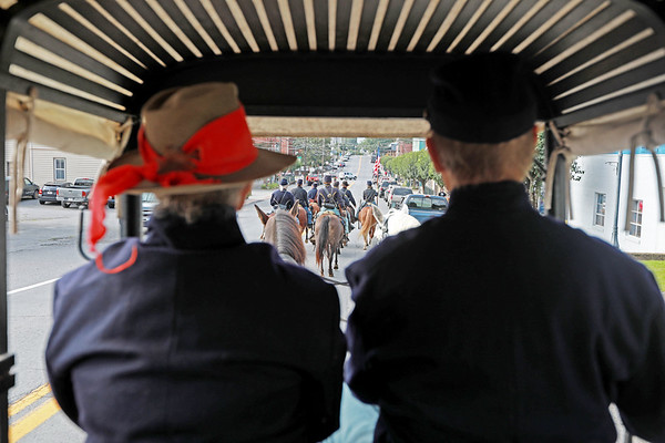 """Civil War re-enactors Lynn and Raymond Tuckwiller drive their horse carriage ambulance into the skirmish prior to the battle between the local Home Guard and the Federal Army as part of Monroe County Heritage Day in Union on Saturday.  The ambulance as well as the Tuckwiller's have made many appearances on the History Channel as well as the major motion picture, """"Lincoln."""" (Chris Jackson/The Register-Herald)"""