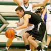 (Brad Davis/The Register-Herald) Westside's Shane Jenkins tries to maintain control along the perimeter as he's pressured by Wyoming East's Logan Mullins during the second boys meeting of the year in the battle for Wyoming County Friday night in New Richmond.