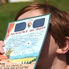 Kara Kesterson, 8, of Boomer, looks at the solar eclipse Monday afternoon at Grandview State Park.<br /> (Rick Barbero/The Register-Herald)