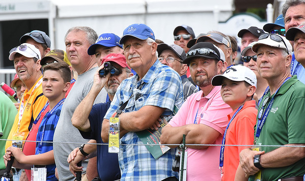 Spectators watching golfers hit tee shots from the 18th hole during the first round of The Greenbrier Classic.<br /> (Rick Barbero/The Register-Herald.com