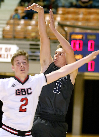 (Brad Davis/The Register-Herald) Independence's Tyler Haga shoots from three-point range before Greater Beckley Christian's Jaydyn Fisher can stop him Friday night at the Beckley-Raleigh County Convention Center.