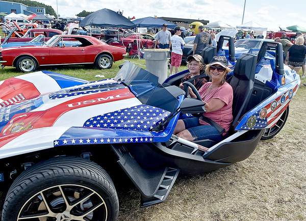 (Brad Davis/The Register-Herald) Cruisin' around during the Friends of Coal Auto Fair July 15 at the Raleigh County Memorial Airport.