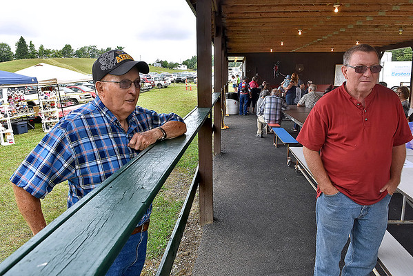 (Brad Davis/The Register-Herald) Henry Lilly, left, mingles during the annual Lilly Family Reunion Saturday afternoon near Ghent.