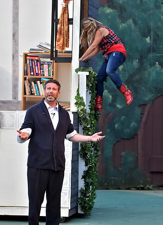 (Brad Davis/The Register-Herald) Ariel slips out her window unbeknownst to her dad Rev. Moore during a scene from Theatre West Virginia's Footloose at Grandview Park's Cliffside Amphitheatre.