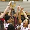 (Brad Davis/The Register-Herald) The Bluefield Beavers celebrate with the trophy after taking the Class AA boys championship at the Big Atlantic Classic Saturday afternoon at the Beckley-Raleigh County Convention Center.