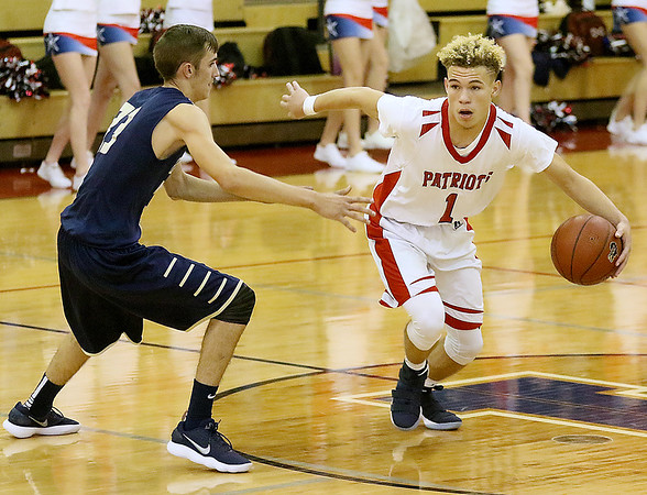(Brad Davis/The Register-Herald) Independence's Donte Webster cuts around Greenbrier West's Chase Hagy Friday night in Coal City.