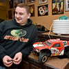(Brad Davis/The Register-Herald) 14-year-old Joe Watson chats with the Register-Herald Sunday afternoon at his Wyco Hollow Road home. He hopes to one day race high-powered R.C. cars for a living, but in the meantime is working to open up a racing facility to serve the area. The body on his R.C. car at right is a replica of one of real-life offroad racer Jimmy Stephenson's past trucks.