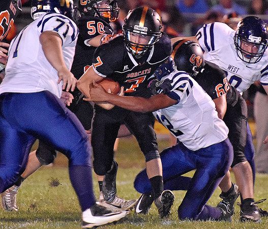 (Brad Davis/The Register-Herald) Summers County's Tucker Lilly rumbles ahead as Greenbrier West's Isaiah Childress (#42) tries to tackle him Friday night in Hinton.