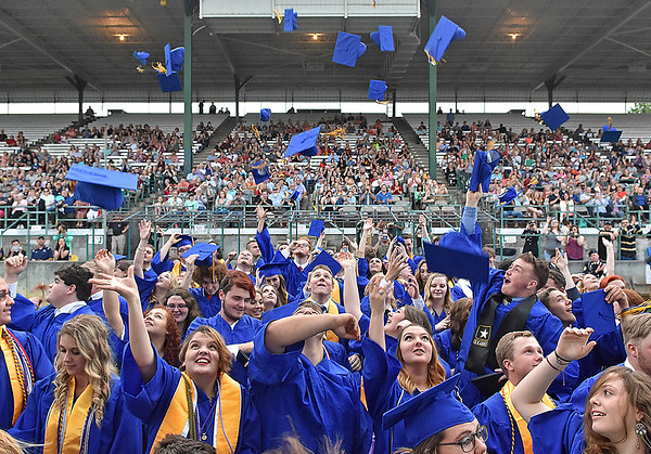 (Brad Davis/The Register-Herald) Caps fly as graduating Greenbrier West seniors celebrate at the conclusion of the school's 2017 Commencement Ceremony Saturday evening at the State Fairgrounds in Fairlea.