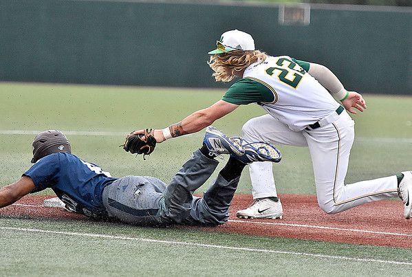 (Brad Davis/The Register-Herald) Miners 3rd baseman John Hagan reaches out and tags Butler baserunner Calvin Scott after catching him in a short rundown between home and 3rd during the Miners' game one division series loss to the Blue Sox Sunday night at Linda K. Epling Stadium.