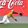 (Brad Davis/The Register-Herald) Miners right fielder Austin Norman dives to make a catch Friday night at Linda K. Epling Stadium. He'd make the play to get the out.