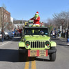 (Brad Davis/The Register-Herald) The Grinch tosses candy and waves to residents as he putters along atop a jeep that matches his skin tone along Main Street in Sophia during the town's annual Christmas Parade Saturday afternoon.