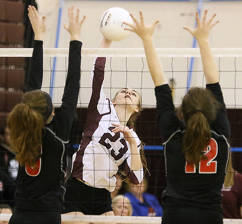 (Brad Davis/The Register-Herald) Woodrow Wilson's Sophie Booth tries to make a kill as St. Albans' Kiersten Eggleton, left, and Brook Clark tys to block it Saturday afternoon at Woodrow Wilson High School.