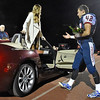 (Brad Davis/The Register-Herald) Indy football player - and gentleman - Caleb Bailes walks over to assist senior Bailee Lester as her escort during the halftime homecoming ceremony Friday night in Coal City.