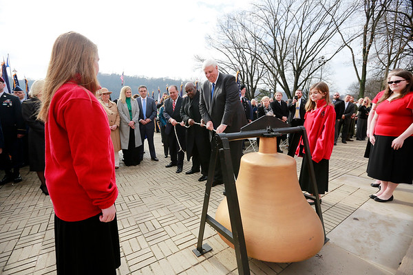 Governor Jim Justice rings a bell in recognition of Dr. Martin Luther King Jr. during his inauguration as the 36th Governor of the State of West Virginia at the Capitol in Charleston on Monday. (Chris Jackson/The Register-Herald)