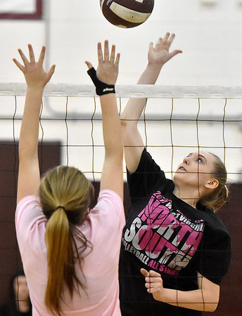 (Brad Davis/The Register-Herald) Class A (black) takes on Class AA (pink) during the West Virginia North/South All-Star Volleyball event Saturday afternoon at Woodrow Wilson High School.