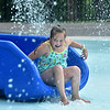 (Brad Davis/The Register-Herald) 7-year-old Jaycee Wooten races down one of the slides inside the Splash Park at Lake Stephens Saturday afternoon.