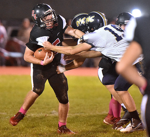 (Brad Davis/The Register-Herald) PikeView running back Hunter Mitchelson is met in the backfield by multiple Nicholas County defenders Friday night in Gardner.