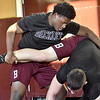 (Brad Davis/The Register-Herald) Woodrow Wilson senior Tyree Swafford, left, grapples with teammate Colton Wright (220-pound weight class) during practice Wednesday afternoon.