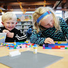 Jake, 3, and Caroline Moore, 7, from Daniels, build with legos during the Kids Classic Rock Out with Legos Event at the Raleigh County Public Library Thursday in Beckley. (Chris Jackson/The Register-Herald)