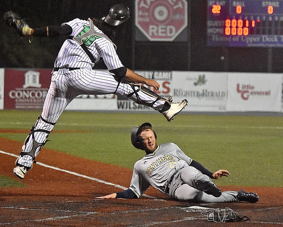 (Brad Davis/The Register-Herald) Marshall catcher Reynaldo Pastrana has to leap to catch the throw as Florida International's Jack Schaaf slides and scores from first base after stealing second, then advancing all the way home after Pastrana's throw got past Herd infielder Sam Finfer during the top of the 5th inning in the second game of Saturday's doubleheader at Linda K. Epling Stadium.