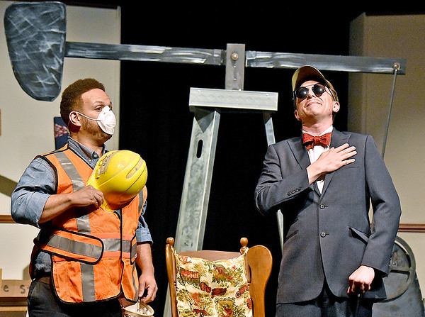 """(Brad Davis/The Register-Herald) Actor and director Robby Moore (left), playing a gas company worker, and Jamie Smith, playing the role of businessman Falcone, perform a scene from """"FRACK!"""" Saturday night at The Raleigh Playhouse & Theatre, a musical comedy written, produced and performed from the ground up entirely by Beckley area talent. Performances are still upcoming with shows running at The Raleigh on Thursday June 22, Friday, June 23 and Saturday, June 24, all at 7:00 p.m. Visit  <a href=""""http://www.Frackmusical.com"""">http://www.Frackmusical.com</a> for more info on the production."""